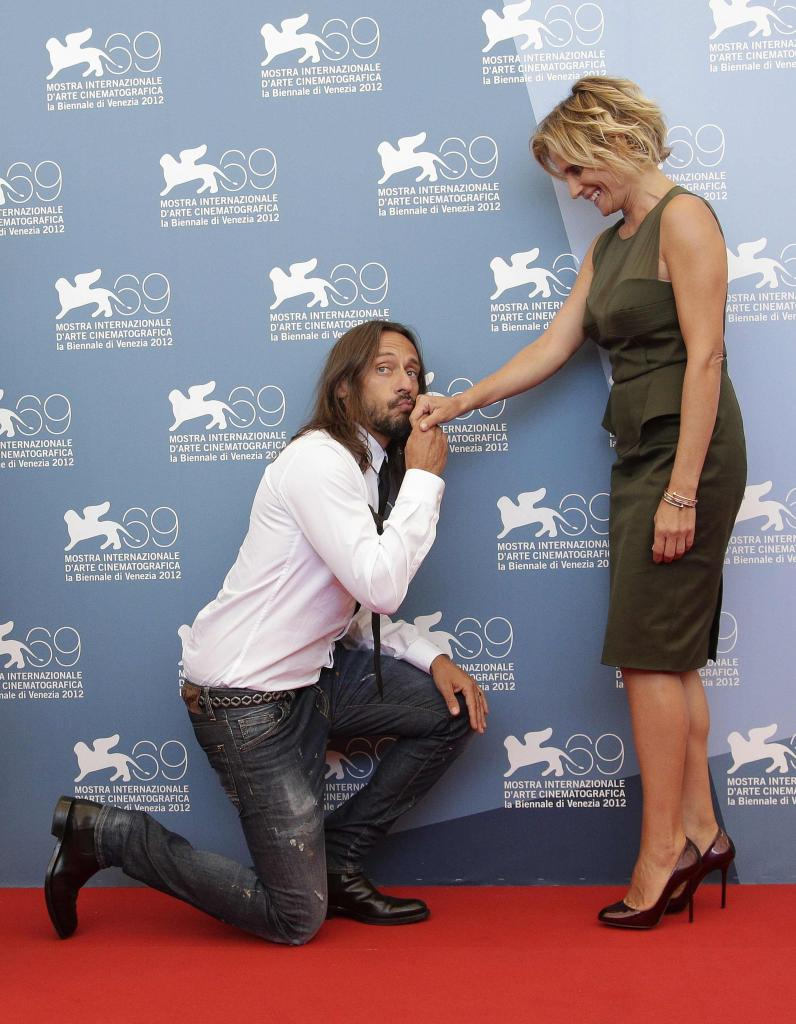 """Members of the jury """"Opera Prima"""" French D.J. Sinclar and Italian actress Ferrari pose during a photocall at the 69th Venice Fil"""