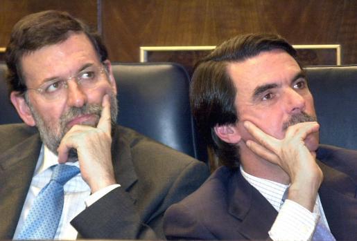 Mariano Rajoy y José María Aznar, en una imagen de archivo.