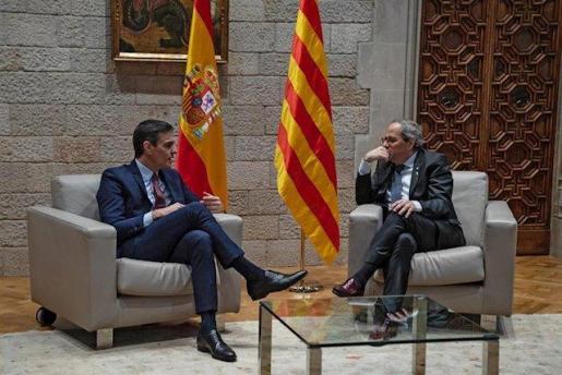 El presidente del Gobierno, Pedro Sánchez, y el presidente de la Generalitat, Quim Torra, durante una reunión en una foto de archivo.