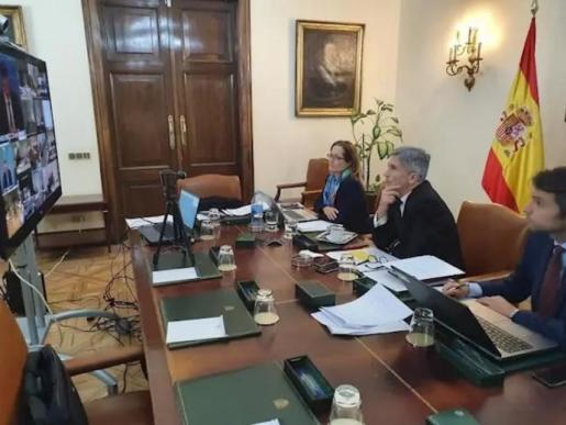 El ministro del Interior, Fernando Grande-Marlaska, en la reunión telemática donde se han restablecido los controles de frontera terrestre por el Covid-19 - INTERIOR