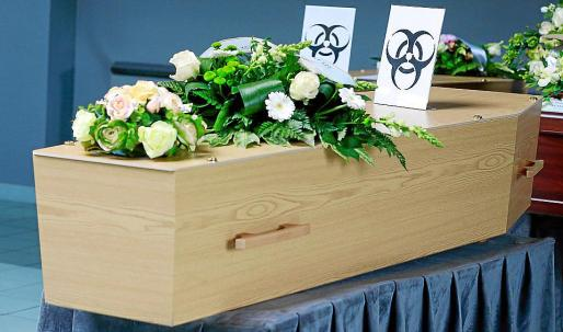 Gilly (Belgium), 03/04/2020.- The coffin of a COVID-19 victim is marked with a 'Biohazard' warning sign at the 'Pompes Funebres Fontaine' funeral service company in Gilly, Belgium, 03 April 2020. Belgium according to a report of the World Health Organization (WHO) had 13,964 total confirmed cases and 828 deaths in total (as of 02 April 2020) from the the SARS-CoV-2 coronavirus which causes the COVID-19 disease. (Bélgica) EFE/EPA/STEPHANIE LECOCQ COVID-19 outbreak in Belgium