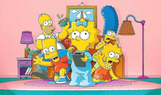 Imagen de la mítica familia Simpson, reunida en el ya legendario sofá de su casa en Springfield.