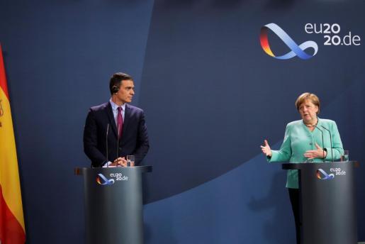 Angela Merkel y Pedro Sanchez.