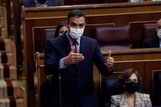 El presidente del Gobierno, Pedro Sánchez, durante su intervención en la sesión de control al Ejecutivo este miércoles en el Congreso para dar cuenta de la gestión de la pandemia.