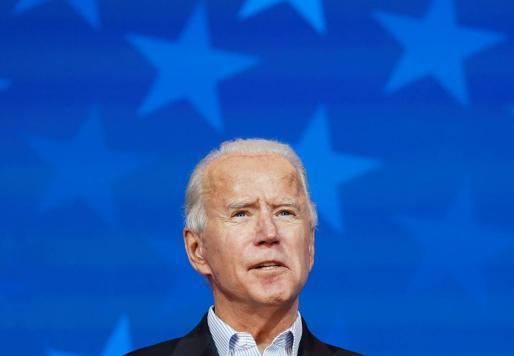 FILE PHOTO: Democratic U.S. presidential nominee Joe Biden makes a statement on the 2020 U.S. presidential election results during a brief appearance before reporters in Wilmington, Delaware, U.S., November 5, 2020. REUTERS/Kevin Lamarque/File Photo USA-ELECTION/BIDEN