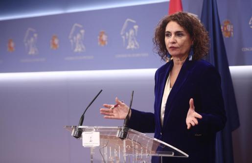 La ministra de Hacienda y portavoz del Gobierno, María Jesús Montero, ofrece una rueda de prensa tras la aprobación de los Presupuestos Generales del Estado (PGE) en el Congreso de los Diputados, en Madrid.