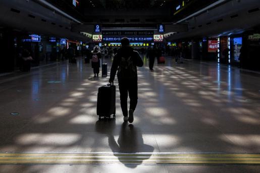 Un pasajero, en Beijing.