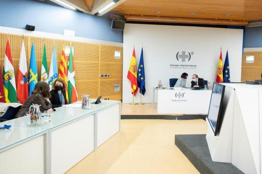 La ministra de Sanidad, Carolina Darias y el titular de Política Territorial y Función Pública, Miquel Iceta , durante el Consejo Interterritorial del Sistema Nacional de Salud.