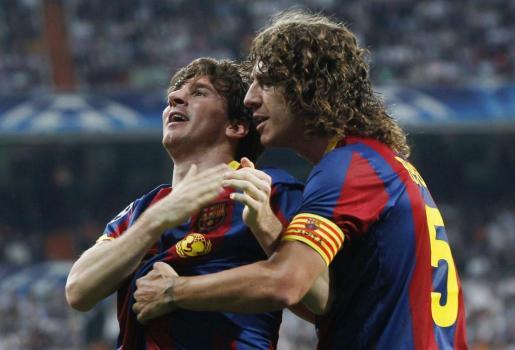 Lionel Andrés Messi y Carles Puyol, celebrando un gol.