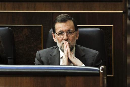El presidente del Gobierno, Mariano Rajoy, durante el pleno del Congreso que debate esta tarde la proposición de ley del Parlamento de Cataluña que pide la transferencia a la Generalitat de la competencia para convocar la consulta soberanista.