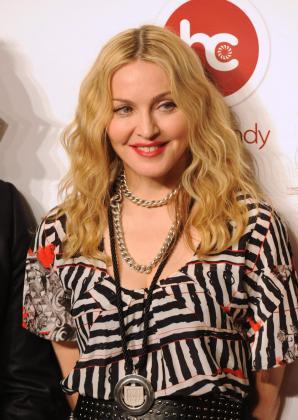 La cantante estadounidense Madonna a su llegada el lunes 29 de noviembre de 2010, a la inauguración, en un barrio exclusivo de Ciudad de México, del primero de diez gimnasios en el mundo de su cadena Hard Candy Fitness.