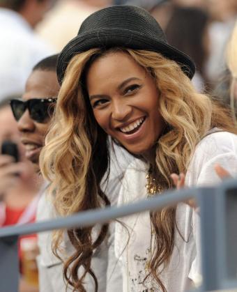 Los cantantes estadounidenses Jay-Z (i) y Beyonce Knowles (d) durante su asistencia a la final del US Open.