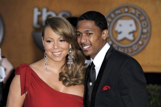 La cantante estadounidense Mariah Carey y su marido, el actor Bick Cannon, posan a su llegada a la gala de los Screen Actors Guild, en Los Àngeles, California (EEUU), en una fotografía de archivo tomada el 24 de enero de 2010.