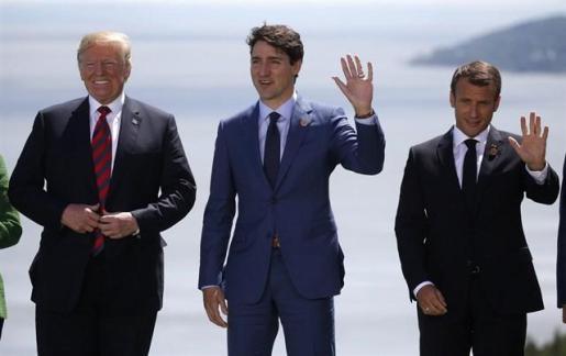 La cumbre del G7 se desarrolla sin grandes avances a pesar del acercamiento de Trump a Macron y Trudeau.