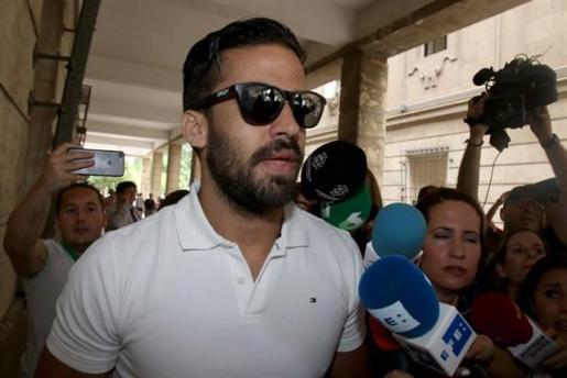 Los cinco miembros de 'La Manada' firman en los juzgados de Sevilla.