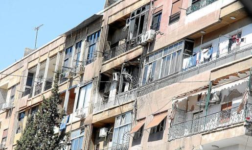 Imagen de algunas viviendas del barrio damasceno de Mezeh, donde ayer se registraron duros combates.