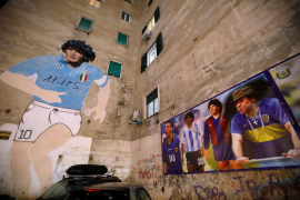 A mural of Argentine soccer legend Diego Maradona is seen in the Spanish Quarter of Naples after the announcement of his death, in Naples