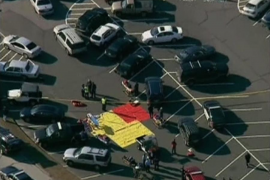Emergency personnel set up in the parking lot after a shooting at Sandy Hook Elementary School in Newtown