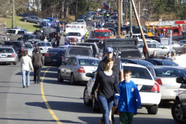 Parents pick-up their children near Sandy Hook Elementary School in Newtown