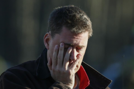 A man mourns nearby Sandy Hook Elementary School were a gunman opened fire on school children and staff in Newtown, Connecticut