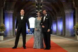 Prince Albert II of Monaco arrives with Luxembourg's Hereditary Grand Duke Guillaume and his wife Princess Stephanie at a gala d