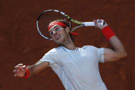 Nadal of Spain serves to his compatriot Ferrer during their men's singles quarter final match at the Rome Masters tennis tournam