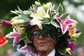 A man wears a hat made of flowers on the first day of the Royal Ascot horse racing festival at Ascot