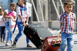 EEUU y Rusia negocian en Ginebra el plan para controlar las armas químicas de Siria