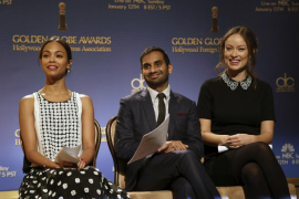 Actors Zoe Saldana, Aziz Ansari and Olivia Wilde sit on stage at the announcement of nominations for the 71st annual Golden Glob