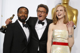 """Director Pawlikowski holds his Oscar for best foreign language film for """"Ida"""" with presenters Ejiofor and Kidman during the 87th"""