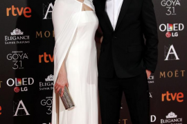 Matthews and Arevalo pose on the red carpet before the Spanish Film Academy's Goya Awards ceremony in Madrid