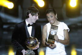 Messi of Argentina and Marta of Brazil hold their World Player 2010 trophies during the FIFA Ballon d'Or 2010 soccer awards cere