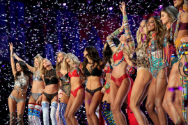 Models celebrate at the end of the 2017 Victoria's Secret Fashion Show in Shanghai