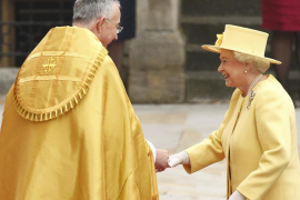 Britain's Queen Elizabeth is welcomed by Right Reverend John Hall Dean of Westminster as she arrives before wedding of Britain's