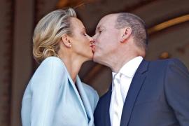 Newlyweds Prince Albert II of Monaco and Princess Charlene kiss on the Palace balcony after the civil wedding service in Monaco