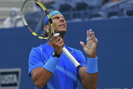 Rafael Nadal of Spain grimaces after a missed shot against Gilles Muller of Luxembourg during their match at the U.S. Open tenni