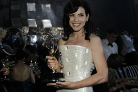 Julianna Margulies holds her Emmy award at the Governors Ball in Los Angeles