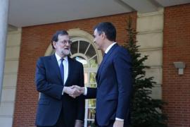 Rajoy y Sánchez acuerdan actuar contra cualquier estructura política que promueva Torra contraria a la Constitución