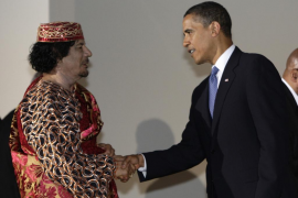 File photo of US President Obama shaking hands with Libya's leader Gaddafi before a dinner at the G8 summit in L'Aquila