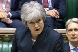 May urge a los diputados a resolver el bloqueo del Brexit