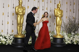 """Jean Dujardin, Best Actor award winner for his role in """"The Artist,"""" departs from backstage with presenter Natalie Portman at th"""