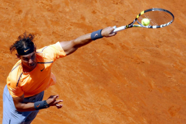 Nadal of Spain serves to his compatriot Ferrer during their match at the Rome Masters tennis tournament